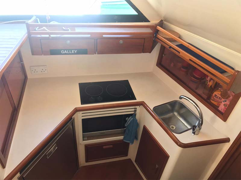Sea Friends Yacht Galley   Riviera 3300 Flybridge Cruiser   Singapore Yacht Charter