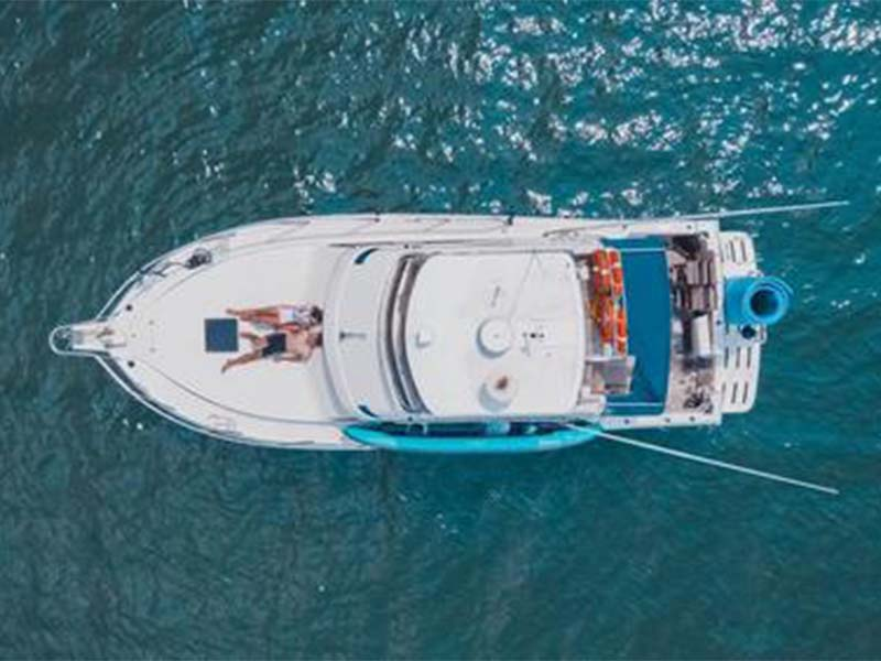 Sea Friends Yacht Top View   Riviera 3300 Flybridge Cruiser   Singapore Yacht Charter