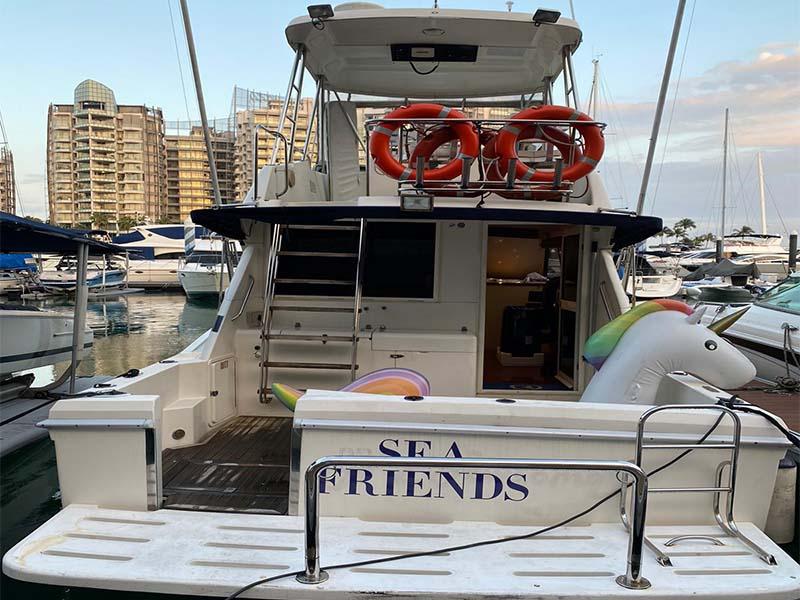 Sea Friends Yacht Stern   Riviera 3300 Flybridge Cruiser   Singapore Yacht Charter