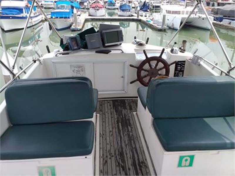 Lady Olivia Yacht Flybridge with Helm | Grand Banks Classic | Singapore Yacht Charter